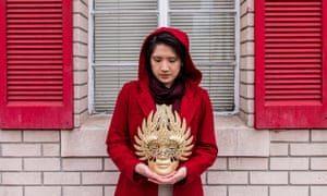 woman mask red coat shutters