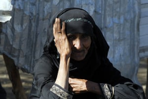 A woman sits in a camp for internally displaced people in Sana'a, Yemen