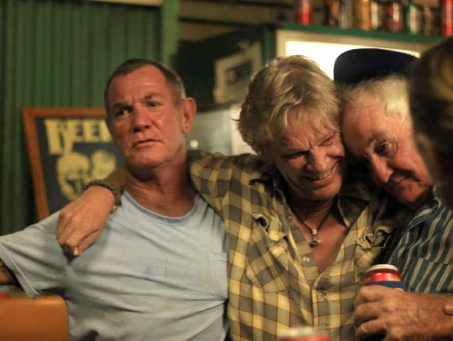 Maurice Buggins, Lars Holm, and Derek Dixon at the Grove Hill Hotel, a historic outback pub in the Northern Territory of Australia, set to close after its owner was unable to find a buyer.