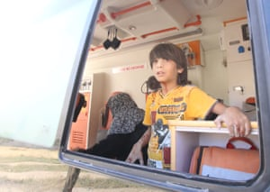 A wounded Syrian boy inside an ambulance following a reported air strike by regime forces and their allies on the city of Maaret al-Noman in Idlib province, Syria