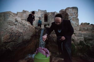 Ultra Orthodox Jews collecting water from the Ein-Walaje spring, near Jerusalem