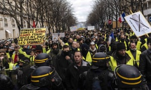 Protesters and riot police face off in Paris on Saturday