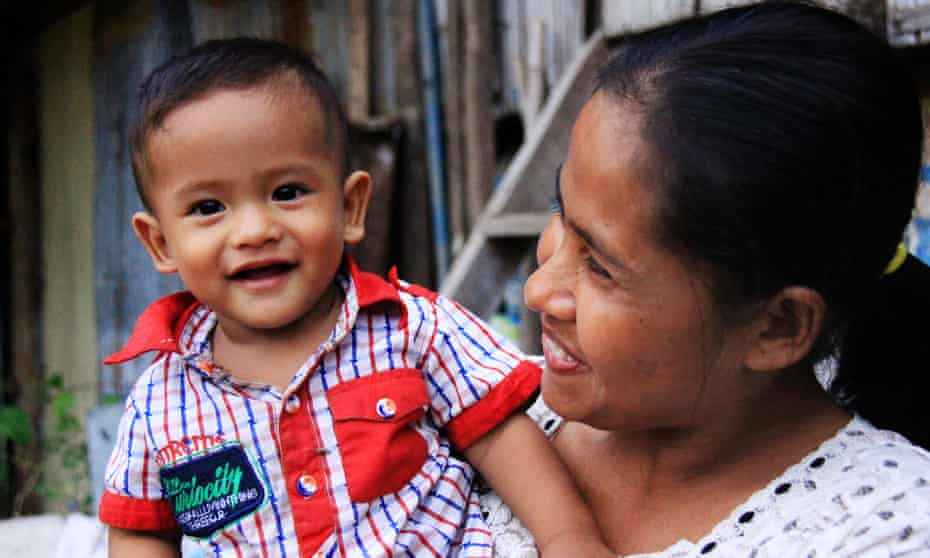 A family in Battambang, Cambodia, supported by the Cambodian Children's Trust which works to keep families together and stop children going to orphanages.