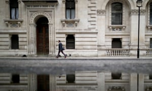 Man walks past government buildings in Whitehall
