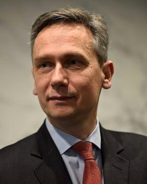 Formal portrait photo of Jean-Sébastien Jacques in a suit and tie