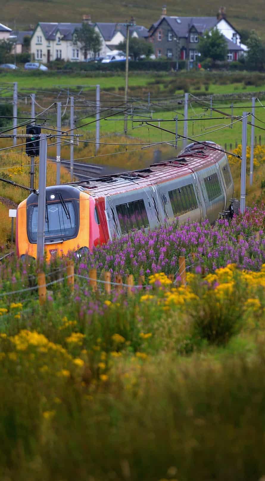 A Virgin train passes along the west coast mainline near Abington in Scotland.