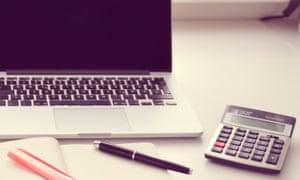 Unhappy maths ... a laptop and a calculator.