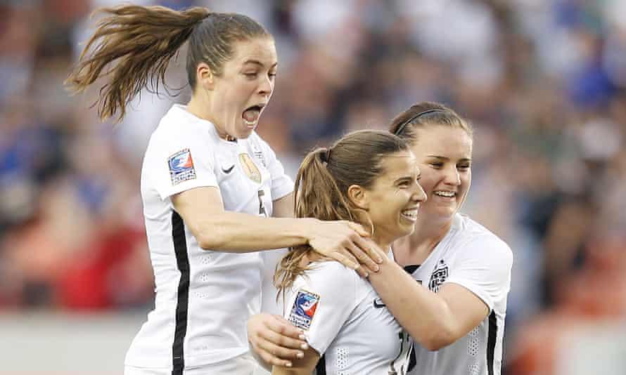 Kelley O'Hara and Lindsey Horan celebrate Tobin Heath's goal against Canada.