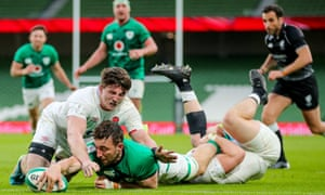Ireland's Jack Conan scores a try despite the best efforts of England's Luke Cowan-Dickie and Tom Curry (left.)