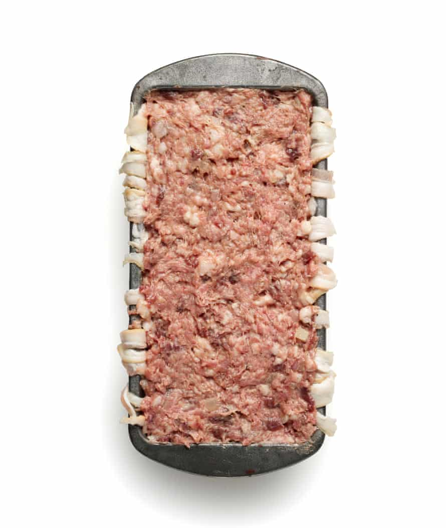 Felicity Cloake's paté de campagne 6. Stuff all the meat and that into the tin.