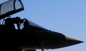 An RAF mechanic checks a plane