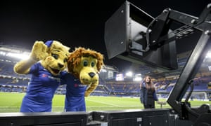 Chelsea mascots Bridget the Lioness and Stamford the Lion check out the VAR monitor.