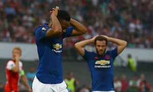 Anthony Martial and Juan Mata look dejected after another missed chance.