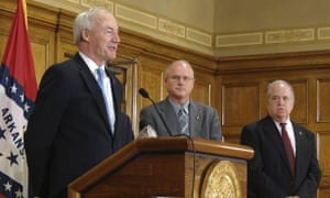 Governor Asa Hutchinson, left, has ordered eight executions in 11 days.