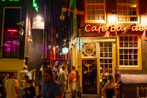 Tourists outside bars in Amsterdam's red light district.