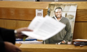 A photo of victim Botham Jean leans against Judge Tammy Kemp's bench during the murder trial of former Dallas police officer Amber Guyger in Dallas.