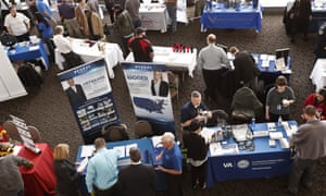 Visitors at a veterans job fair meet with recruiters at Heinz Field in Pittsburgh, Pennsylvania on 7 March.