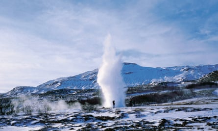A person photographing geysir Strokkur in Haukadalur, south-west Iceland.