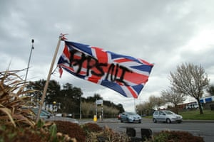 PSNI is written across a union jack in the middle of the Cloughfern roundabout, north Belfast, after rioting by loyalist youths.