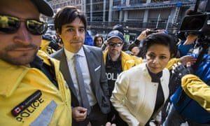 Former CBC radio host Jian Ghomeshi arrives to court with his lawyer Marie Henein, right, in Toronto, on Wednesday.