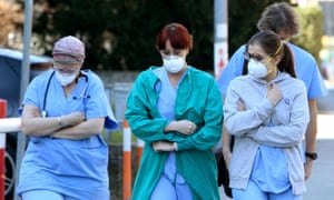 People and health workers wear protective face masks outside the hospital in Padua, Veneto region, northern Italy,.
