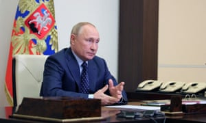 Vladimir Putin attends a meeting with members of the security council via a video link at his residence outside Moscow