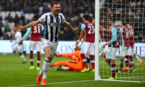 Gareth McAuley celebrates scoring West Brom's second goal against West Ham.
