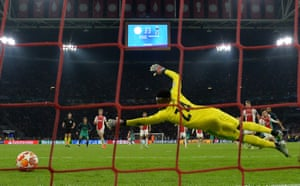 Andre Onana of Ajax dives as Lucas Moura of Tottenham Hotspur (obscured) scores his team's third goal.