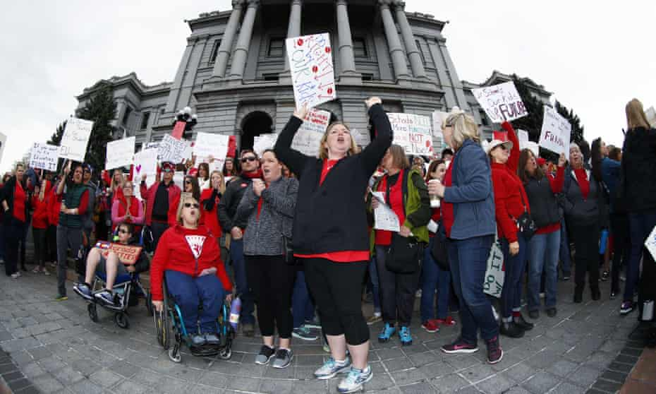 Teachers protest against low pay and school funds in Denver, Colorado, on 26 April.