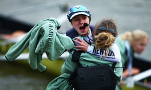 Cambridge cox Sophie Shapter, wearing cap, celebrates their victory.