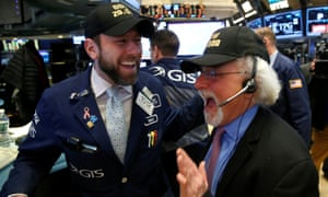 Traders on the trading floor of the New York Stock Exchange as the Dow opens above 20,000