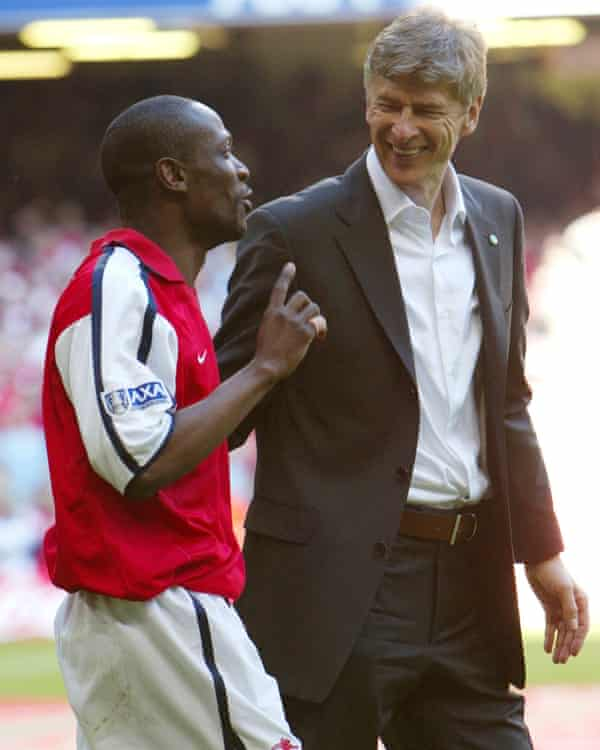 Lauren celebrates with Arsène Wenger after beating Chelsea in the 2002 FA Cup final.