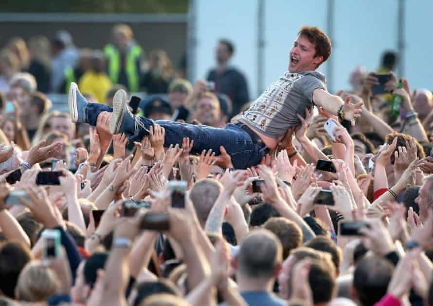 Mobbed … James Blunt crowd surfs at the Invictus Games opening ceremony in London, 2014.