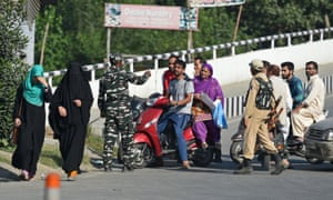 Indian government forces stop Kashmiri civilians at a checkpoint in Srinagar, September 2019