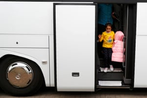 Syrian refugees disembark from a bus on arrival at the camp for refugees and migrants in Friedland, Germany. The first group of Syrian refugees arrived in Germany by plane from Turkey under a new deal between the European Union and Ankara