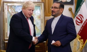 Ali Shamkhani (right), Iranian secretary of the supreme national security council, shakes hands with Boris Johnson in Tehran