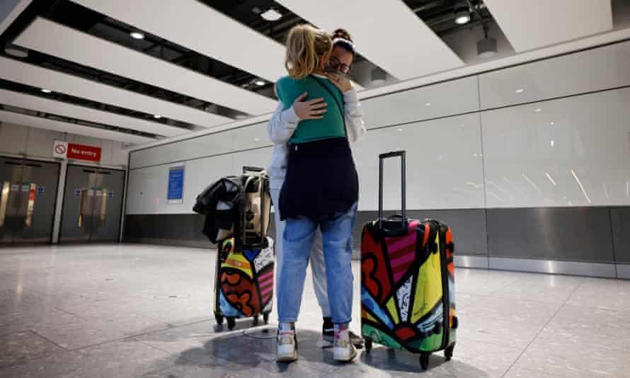 Relatives embrace at Heathrow's terminal 5 last week.