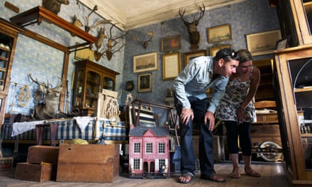 Visitors looking at objects inside Calke Abbey, Derbyshire