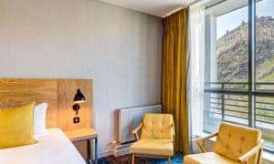 Bedroom with a view of Edinburgh Caste at Apex Grassmarket Hotel, Edinburgh, Scotland.
