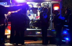 A man is looked after in an ambulance after a police shooting