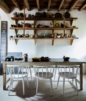 Go with the grain: exposed beams and home-made lights in the dining room.