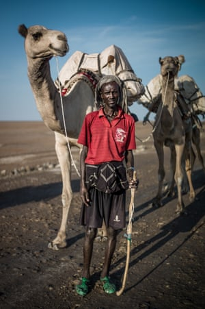 """The Danakil Depression in north-east Ethiopia is one of the hottest, lowest and most inhospitable places on the planet. But it is here, at Lake Afrera, that the Afar people mine from the hard earth what's known as """"white gold"""", or salt."""