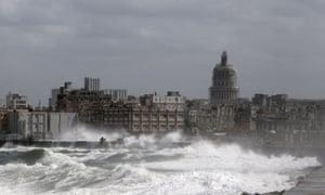Cuba for sale havana is now the big cake and everyone is waves break over havanas seaside promenade sciox Image collections
