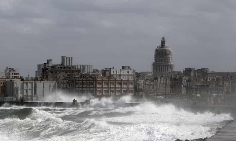 Waves break over Havana's seaside promenade.