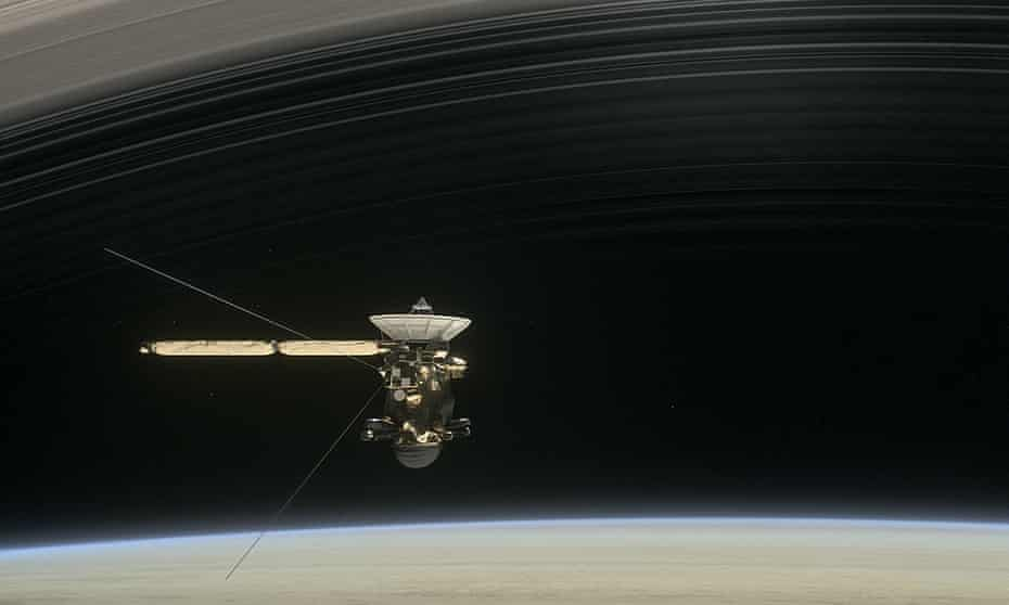 A still from the short film Cassini's Grand Finale, with the spacecraft diving between Saturn and the planet's innermost ring