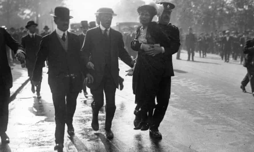 Emmeline Pankhurst is carried from a suffragette protest in 1914.