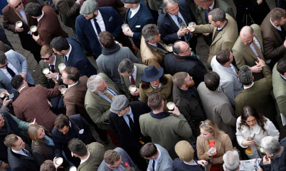 Racegoers socialising at Cheltenham on the last day of the festival.
