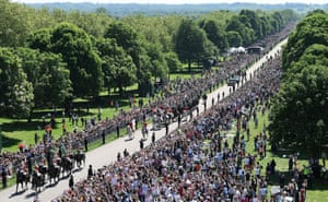 Britain's Prince Harry, Duke of Sussex and his wife Meghan, Duchess of Sussex during their carriage procession on the Long Walk as they head back towards Windsor Castle