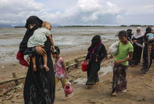 Rohingya Muslims, fled from ongoing military operations in Myanmars Rakhine state, walk to a makeshift camp on hills at Cox's Bazar, Bangladesh.