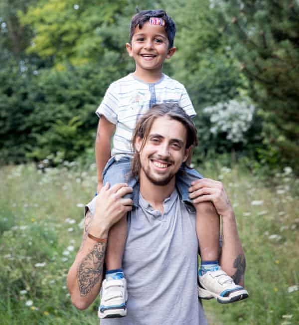 Mobile Refugee Support volunteer Charlie Whitbread, 31, pictured with refugee Mohammed, four, from Kurdistan